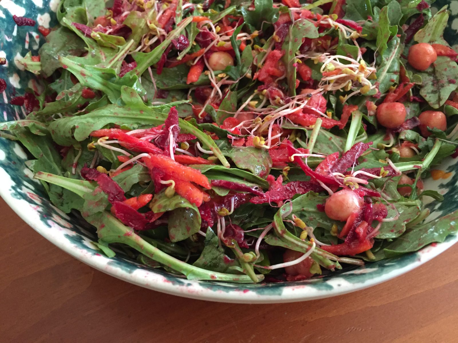 Image of salad with arugula, beets, chick peas